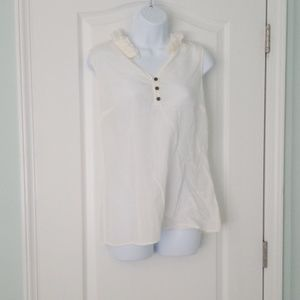 Sleeveless button up blouse with ruffled collar